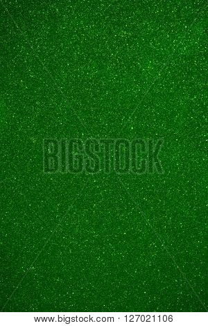 shiny particles green background