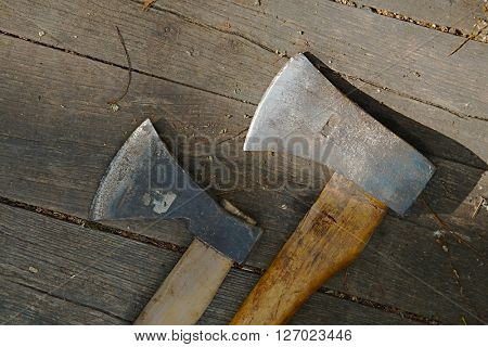 Two axes on a wooden surface
