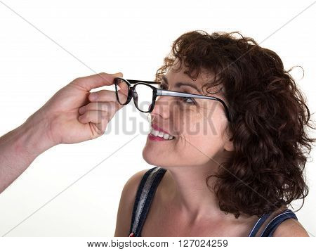 Hands Of Optician Putting Glasses To Woman Isolated On White