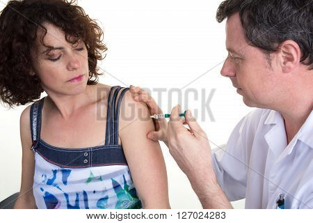 Happy Doctor Giving An Injection To Female Patient At Office