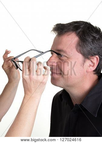 Female Optician Offering Glasses Frames To Male Customer Isolated