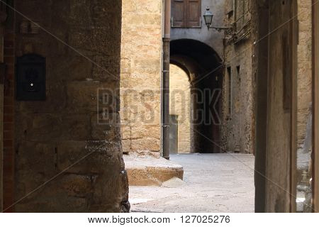 Some details of medieval Italian cities. Classic routes of medieval centers at Volterra