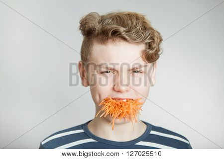 Handsome Boy With A Mouthful Of Grated Carrot