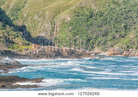 STORMS RIVER MOUTH SOUTH AFRICA - FEBRUARY 28 2016: The view from the restaurant towards the mouth of the Storms River with the suspension bridge just visible above the rocks