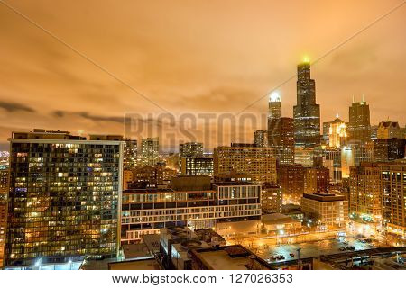 CHICAGO, IL - MARCH 27, 2016: view of The Willis Tower at night. The Willis Tower, built and still commonly referred to as Sears Tower, is a 108-story, 1,451-foot skyscraper in Chicago.
