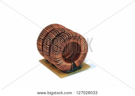 Three industrial toroidal choke coil isolated on white background
