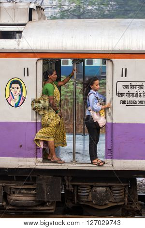 Mumbai, India - February 29, 2016: Unidentified women traveling via Suburban train in ladies only carriage in Mumbai, India.