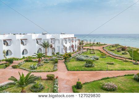 MARSA ALAM , EGYPT, MARCH 27, 2016: Three Corners Equinox Beach Hotel at Red Sea shore - hotel gardens
