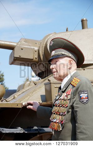 Defender of Stalingrad veteran of World War II colonel Vladimir Semenovich Turov at the T-34 tank