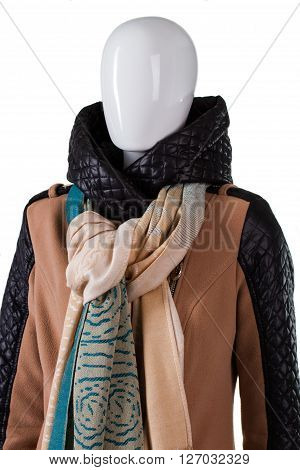 Tied scarf over hooded jacket. Female mannequin wearing stylish scarf. Quilted hood and trendy scarf. Autumn discounts in outlet shop.