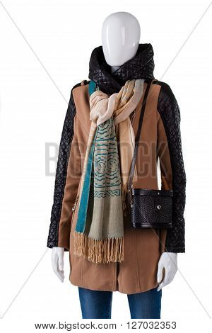 Scarf with jacket and purse. Female mannequin wearing trendy scarf. Dark handbag with brown garment. Brand new outerwear in stock.