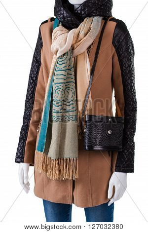 Retro purse and trendy scarf. Jacket with purse on mannequin. Lady's autumn look idea. Stylish apparel from new boutique.