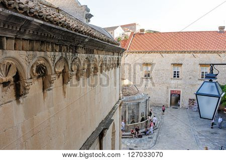 DUBROVNIK CROATIA - AUGUST 31 2009: Church of St. Saviour cornice with peak ornaments and mutules