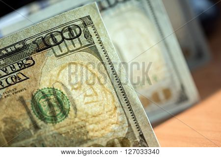 Stack of one hundred dollar bills close-up
