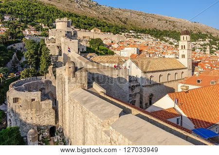 DUBROVNIK CROATIA - AUGUST 31 2009: Outer view of the western defense walls Pile gate Minceta tower and Franciscan monastery