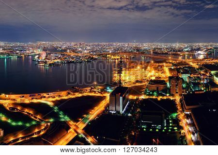 Osaka urban city sea port at night rooftop view. Japan.