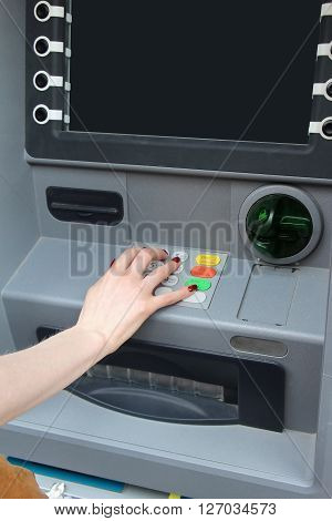 Female hand pressing pin code into atm ** Note: Visible grain at 100%, best at smaller sizes
