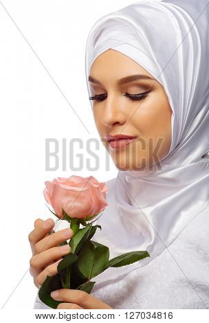 Muslim woman in white dress with rose isolated