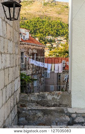 Laundry hanging out to dry on a clothesline in the old city of Dubrovnik