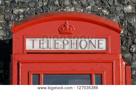 Red iconic British telephone kiosk or box.