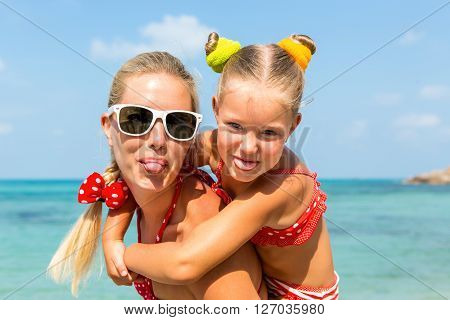 Cute Girl And Beautiful Mother On The Beach