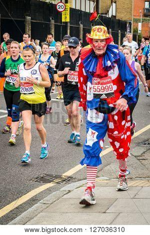 London United Kingdom - April 24 2016: London Marathon 2016. Runners in great costumes. Clown costume