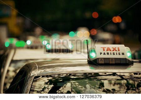 Taxi lined up in street in Paris