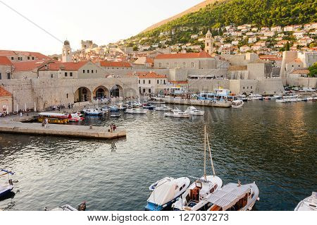 DUBROVNIK CROATIA - AUGUST 31 2009: Old city port and pier Dominican monastery and Arsenal