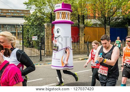 London United Kingdom - April 24 2016: London Marathon 2016. Runners in great costumes. Lighthouse costume