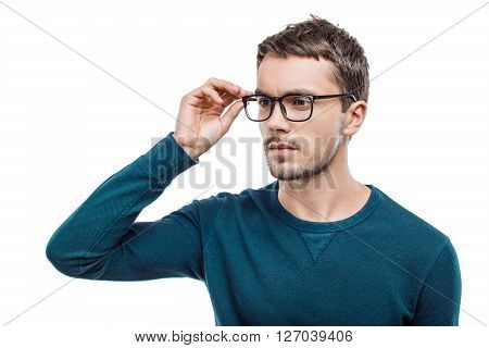 Portrait of stylish handsome young man isolated on white background. Man wearing glasses