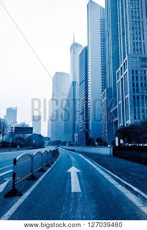city,building,road under blue sky,shanghai china,blue toned image.