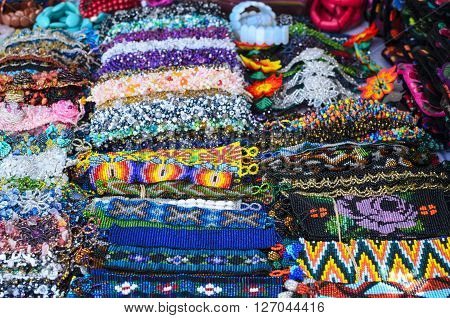 Numerous authentic handmade bid wristbands at the market in Mexico
