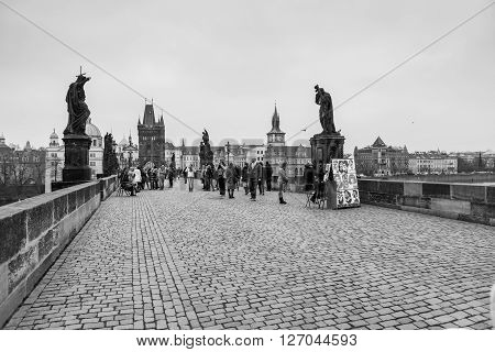 PRAGUE, CZECH REPUBLIC - FEBRUARY 13, 2015: Charles Bridge a famous historic bridge that crosses the Vltava river in Prague on February 13, 2015. Prague is the capital and largest city of Czech Republic.