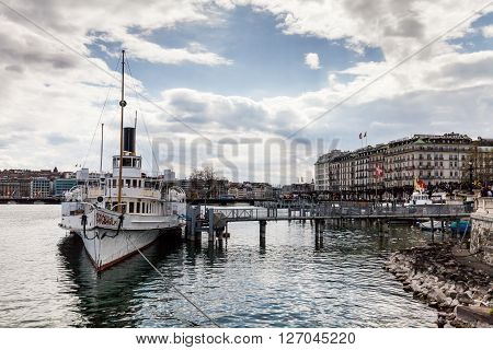 GENEVA, SWITZERLAND - APRIL 11, 2015: Exterior views of the buildings and fountain at the Geneva Lake on April 11 2015. Its the second most populous city in Switzerland (after Zurich).