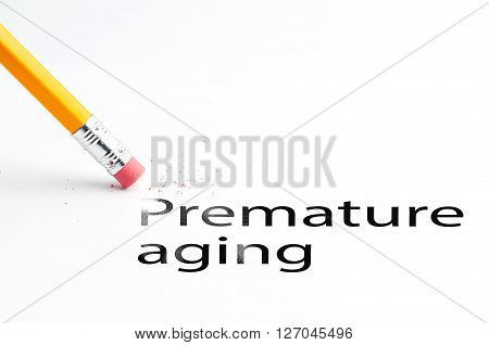 Closeup of pencil eraser and black premature aging text. Premature aging. Pencil with eraser.