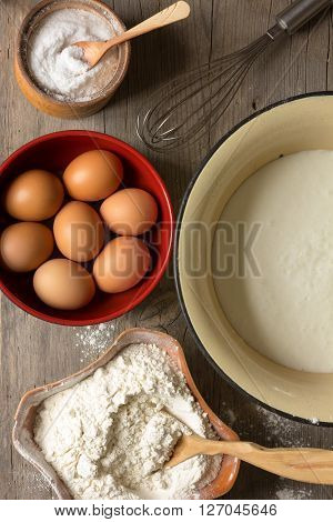 flour eggs whisk in a cup of kefir and for the preparation of dough. view from above close-up