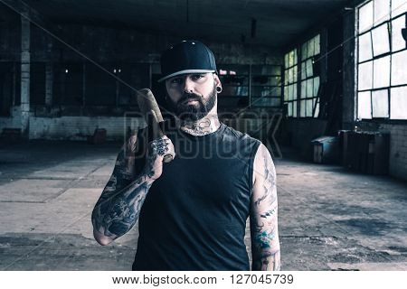 Tattooed Man With The Hammer