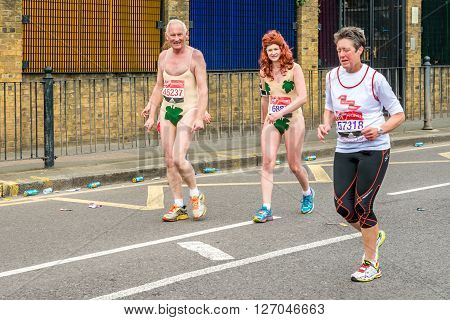 London United Kingdom - April 24 2016: London Marathon 2016. Runners in great costumes. Adam and Eve costume -
