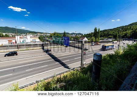 NEUENHOF, SWITZERLAND - JULY 21, 2015: Views of the motorway A1 near the Baregg Tunnel and the cities of Baden Neuenhof and Wettingen on July 21 2015. The motorway A1 ist the oldest in Switzerland.