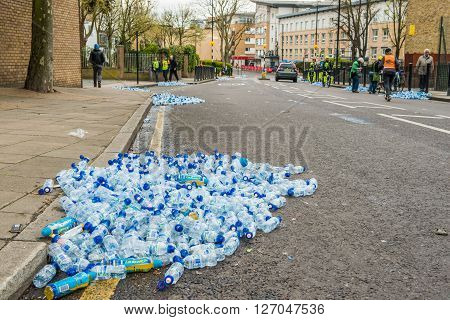 London United Kingdom - April 24 2016: London Marathon 2016. Post-marathon cleaning. Lots of empty water and eregry drinks bottles