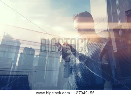 Double exposure photo man touching screen smartphone.Picture bearded trader manager in modern loft.Contemporary city skyscrapers background. Film and bokeh effect.