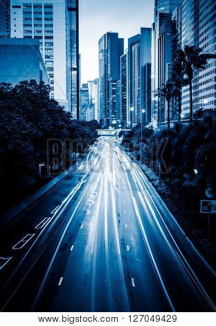 light trails in the downtown district,hongkong china,blue toned image.