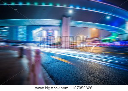 Car light trails and urban landscape in shanghai