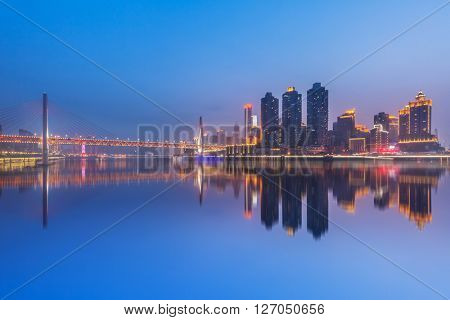 Chongqing,China night cityscape at the Jialing River and Qianximen Bridge