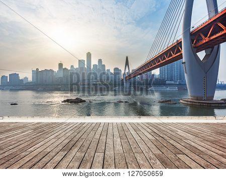 skyline,river and bridge during sunset,chongqing china.