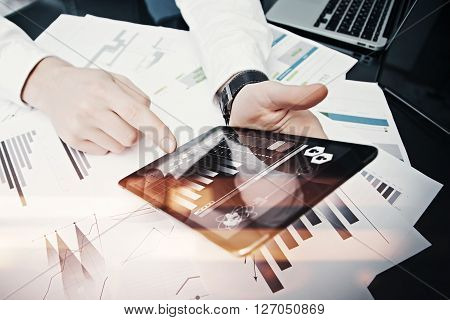 Photo trader work market report modern tablet.Using electronic device.Graphic icons, stock exchanges report screen.Horizontal