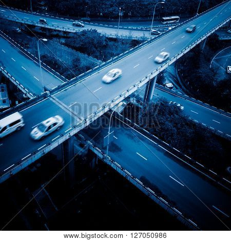 traffic on chongqing caiyuanba overpass,blue toned image.