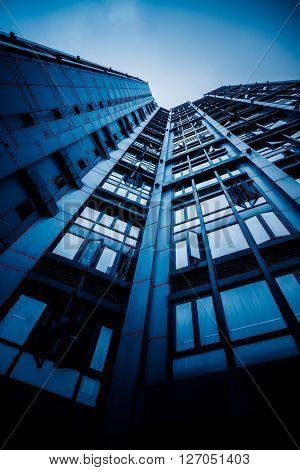 low angle view of highrise building,blue toned image,shanghai china.