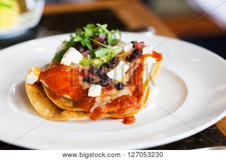 huevos rancheros - traditional mexican dish for breakfast with eggs beans and tortillas