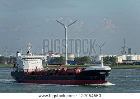 Large oil tanker in dock canal loaded with goods